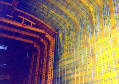 Railroad tunnel construction featuring epoxy coated rebar
